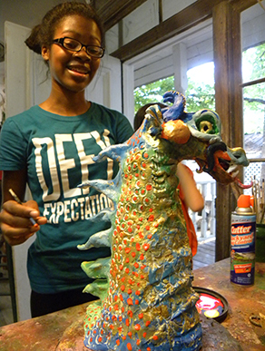 Paint a clay dragon sculpture made in class.